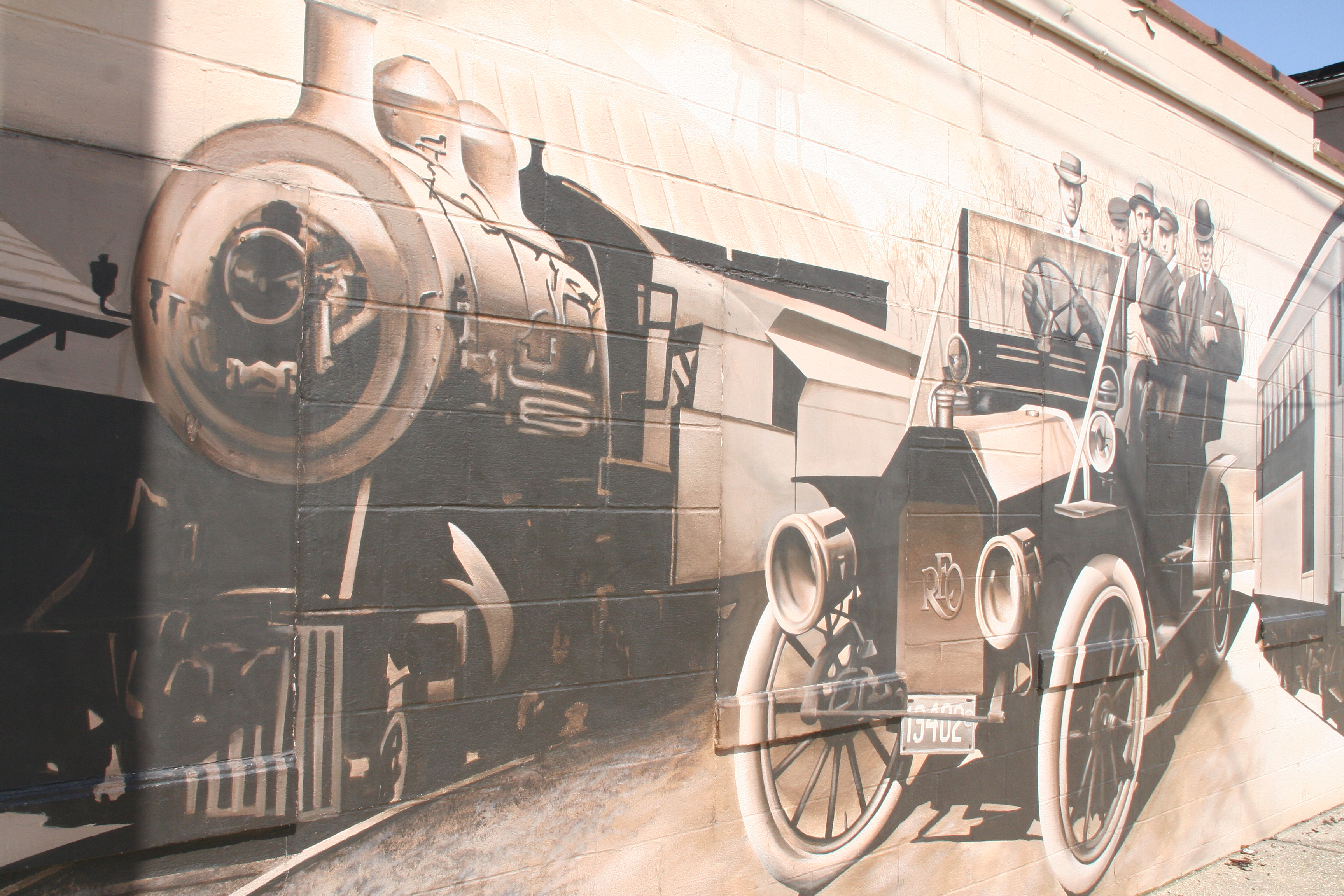 Train and old car on the mural
